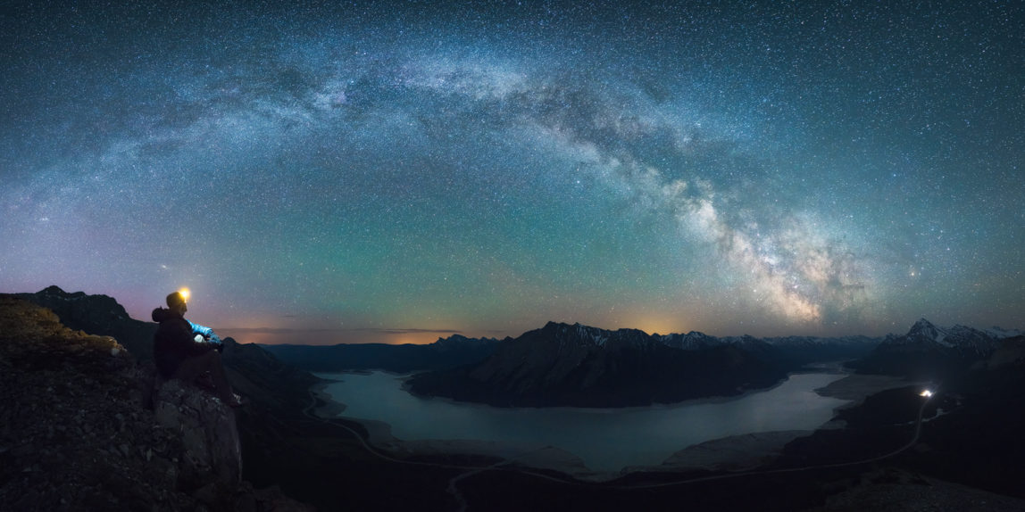 A panorama of the milky way above Abraham Lake in Mat from Vision Quest Mountain, Alberta, Canada