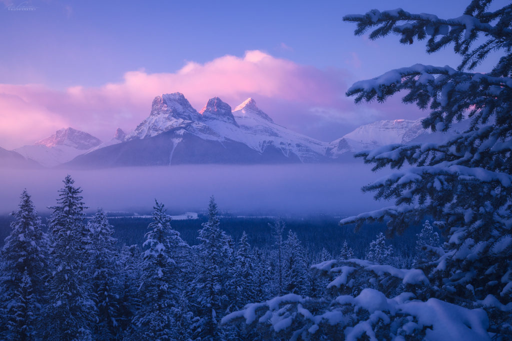 The Three SIsters during some atmospheric winter weather, Canmore, Alberta, Canada