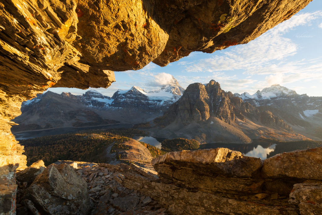 The view from under a rock overhang on the Nublet looking towards Mt Assiniboine at sunset.