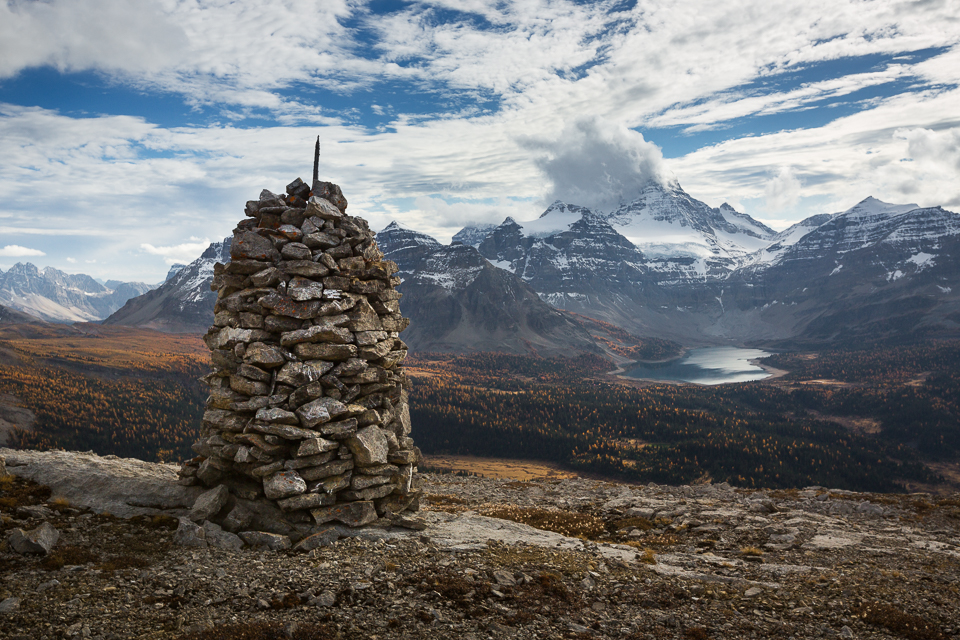 A perfect and large summit cairn on Cave Mountain with a grand view towards Mt Assiniboine and Lake Magog.
