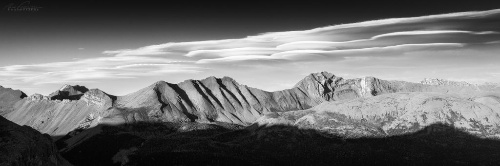 A black and white 3:1 panorama of Og Mountain with lenticular clouds above, Mt Assiniboine Provincial Park, BC, Canada