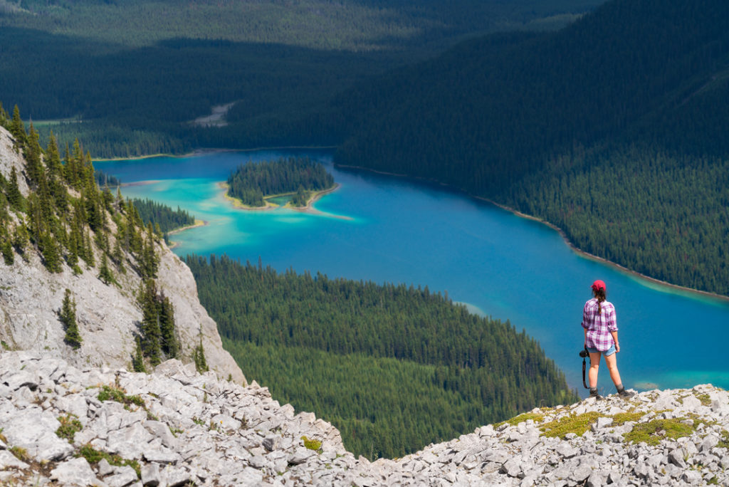 Admiring the Caribbean colored waters of Marvel Lake from Marvel Lake viewpoint, Banff National Park, AB, Canada