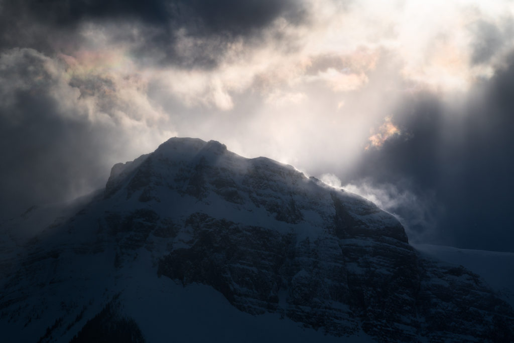 Cloud iridescence along the top of Mt Turner on the edge of banff National Park