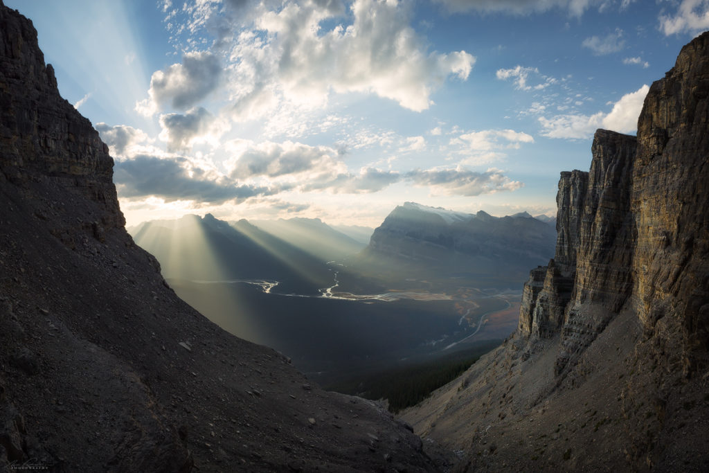 Crepuscular Rays forming at Saskatchewan River Crossing at sunset during the ascent of Mt Murchison.
