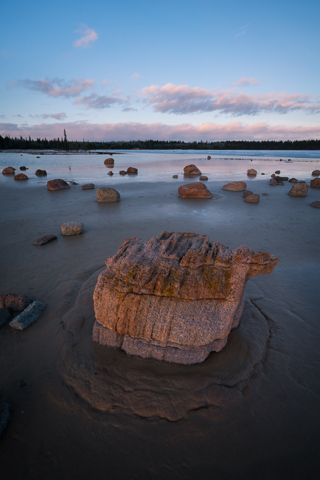 Scattered glacial erratics along the sandy shoreline of Grosbeak Lake, Wood Buffalo National Park, Alberta, Canada