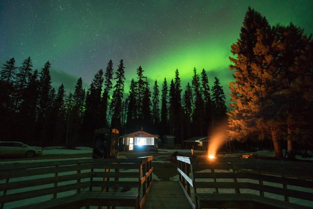 The sky circle at Pine Lake with the aurora boealis above, Wood Buffalo National Park, Alberta, Canada