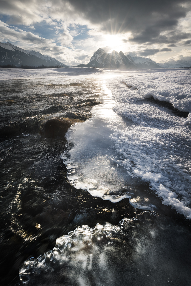 The icy edge of a river on Abraham Lake at sunrise, Kootenay Plains, David Thompson Country, Alberta, Canada
