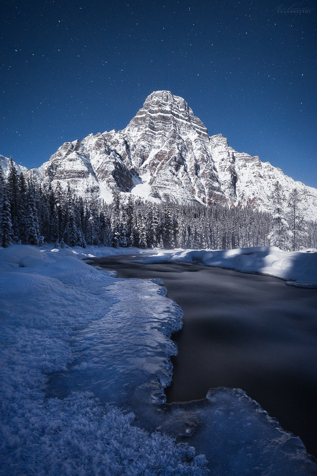 Mt Chephren under moonlight on a cold winters night, Banff National Park, Alberta, Canada