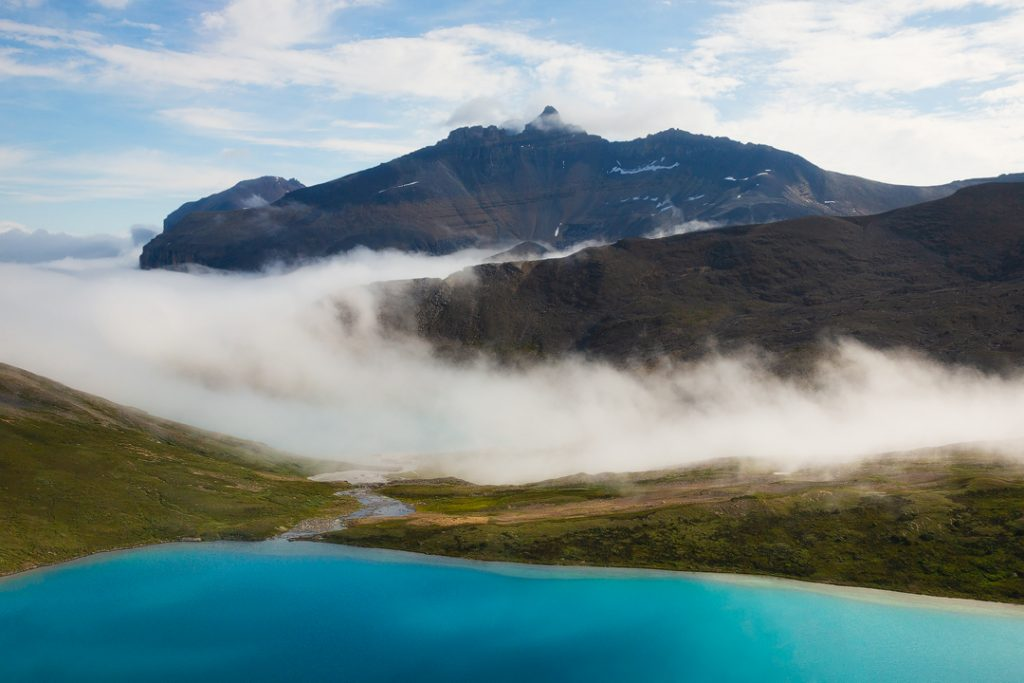 An aerial view of Michelle Lakes with inversion fog and Whitegoat Peaks behind, Alberta, Canada