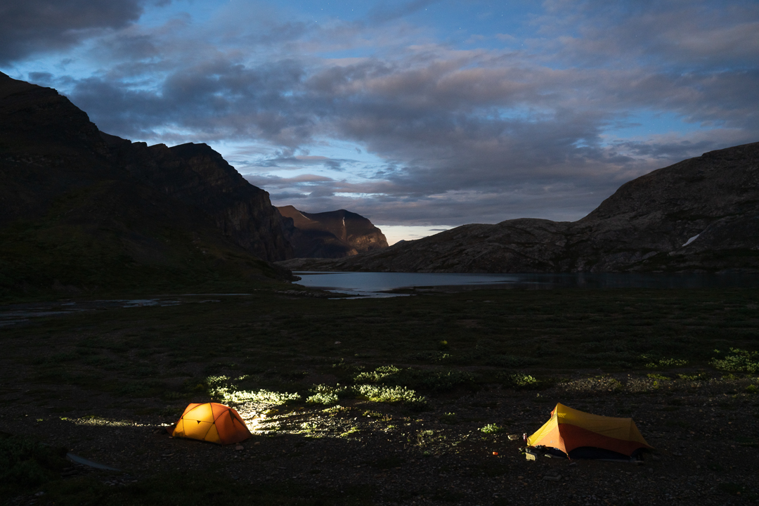Two tents camped near Lower Michelle Lakes illuminated in the darkness, Alberta, Canada