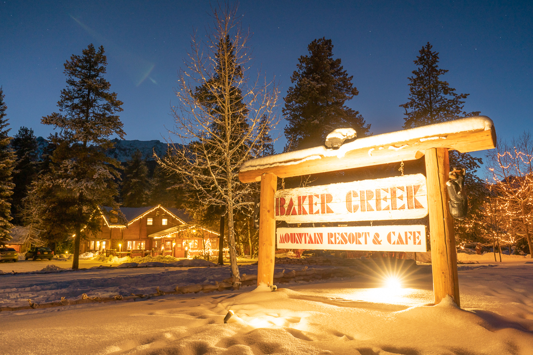 Baker Creek Mountain Resort front entryway with lit up sign saying 'Baker Creek Mountain Resort & cafe'