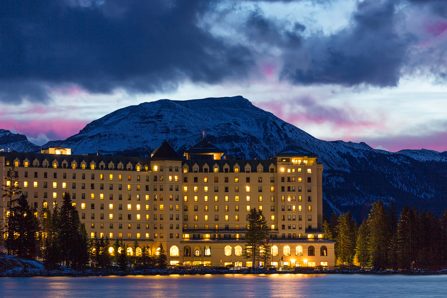 The Fairmont Chateau Lake Louise lit up at sunrise