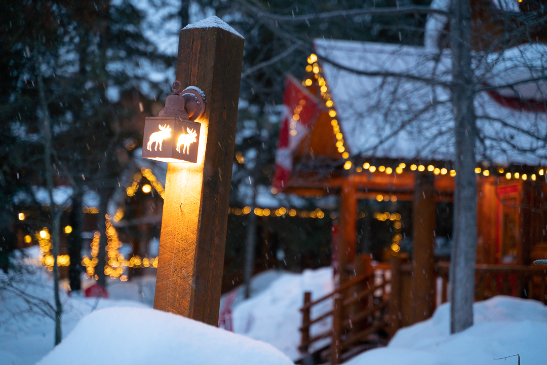 The front entrance to baker Creek Mountain Resort illuminated by festive lights.