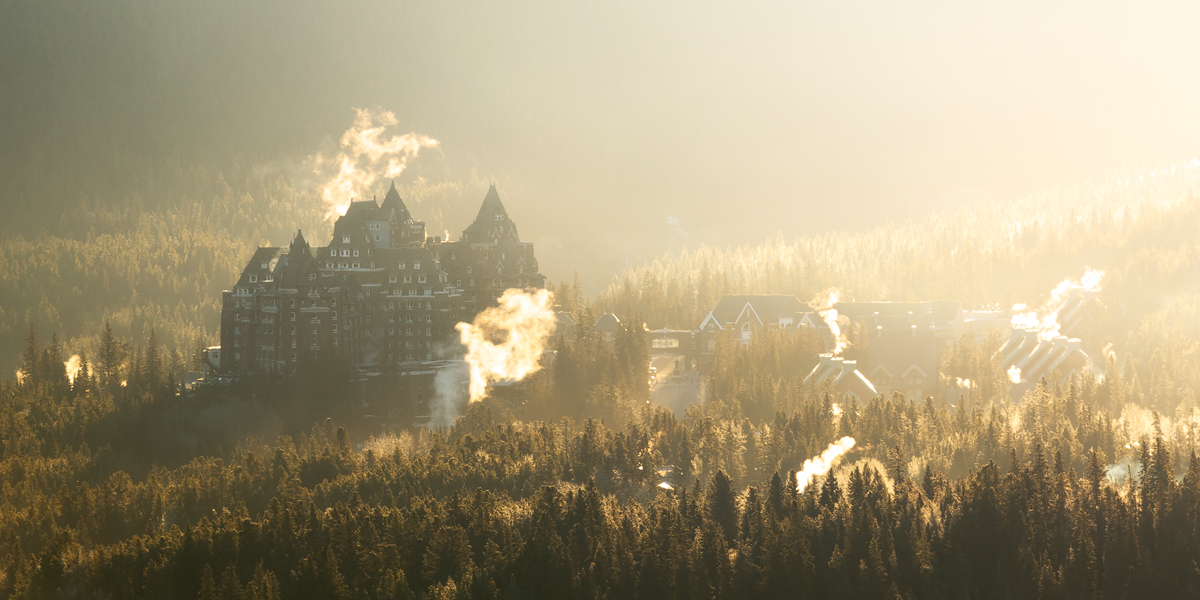 The Fairmont Banff Springs rising from the forests on the outskirts of Banff.
