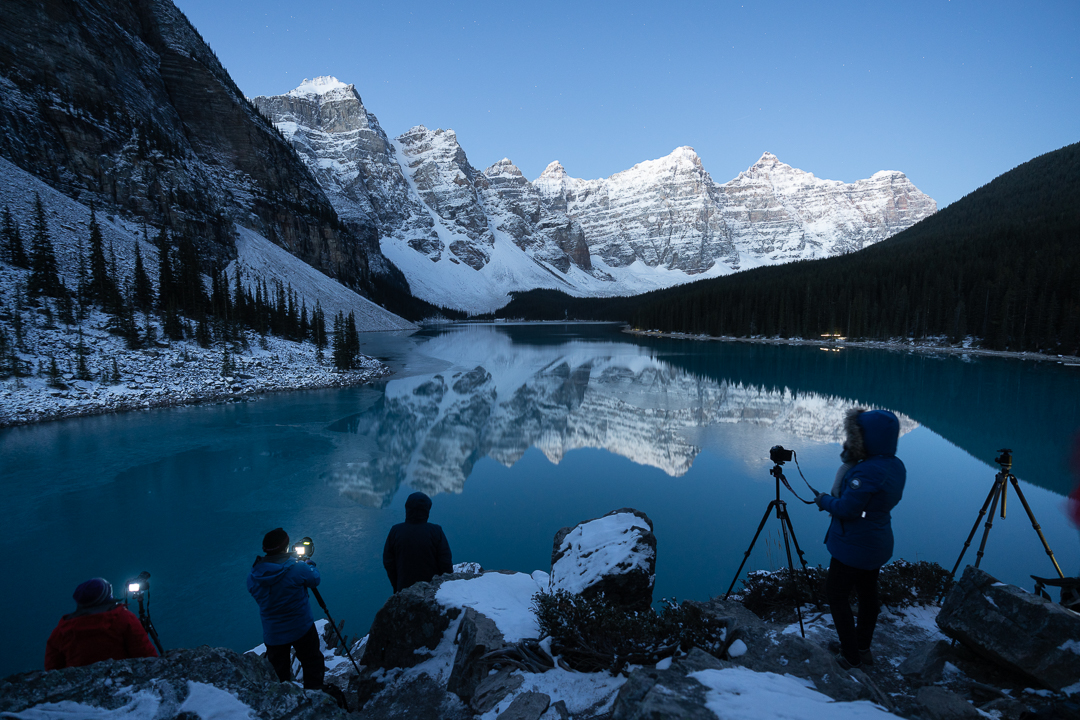 A photography workshop group preparing to photograph Moraine lake from the rockpile.