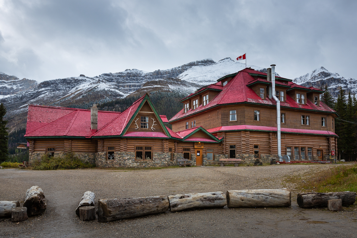 Num Ti Jah Lodge and its famous red roof on an overcast day in Banff National Park.