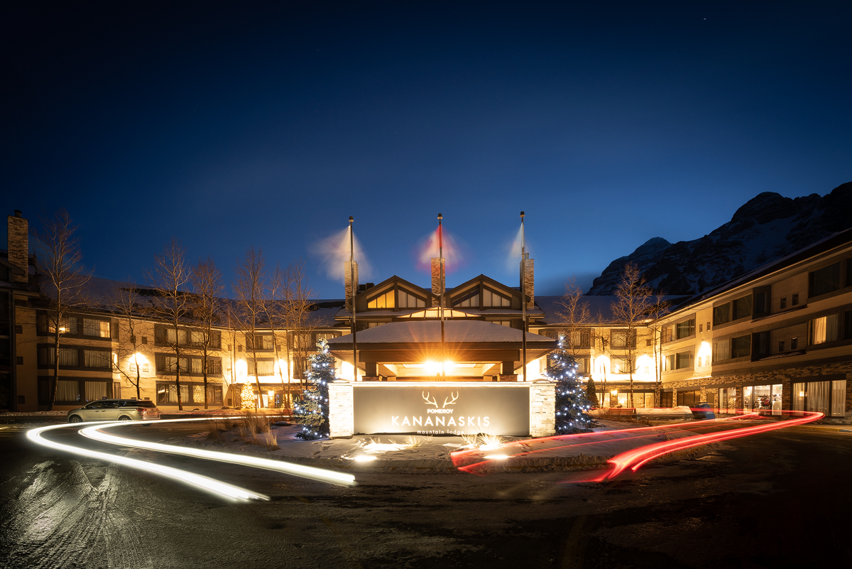 Traffic trails at the main entrance to Pomeroy kananaskis Mountain Lodge as night falls.