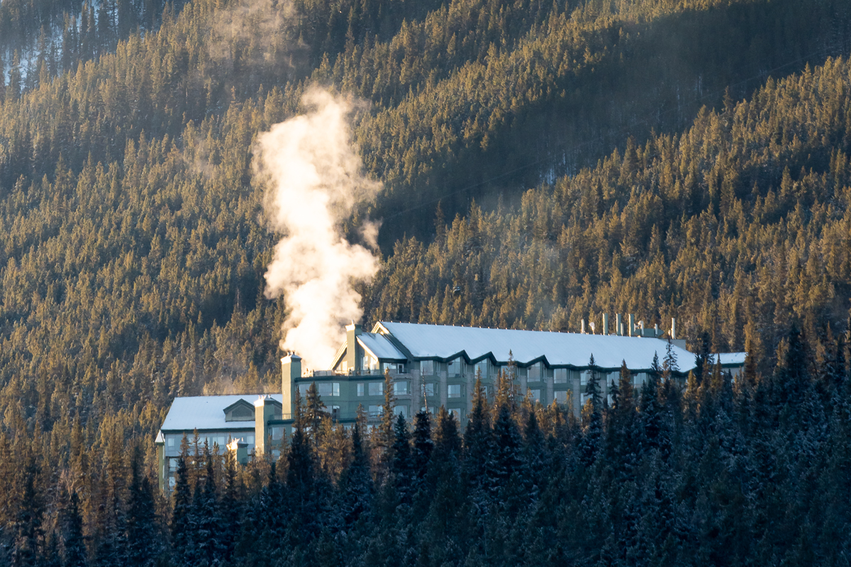 Steam rising from the Rimrock Hotel on a winter morning as the light just starts to hit it.