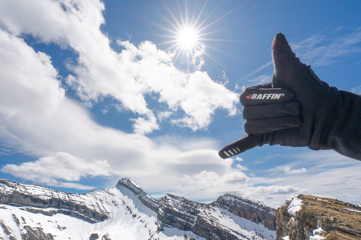 The BAFFIIN glove liner enjoying the sun on top of Red Ridge in Kananaskis with Mt Bogart behind.