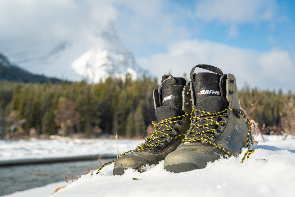 BAFFIN Borealis winter boots in The Canadian Rockies which were taken off before a river crossing of Silverhorn Creek.