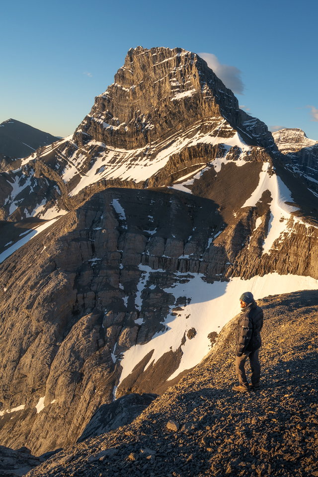 The BAFFIN 800 fill down jacket keeping me warm during sunrise on top of Windtower Mountain in The Canadian Rockies.
