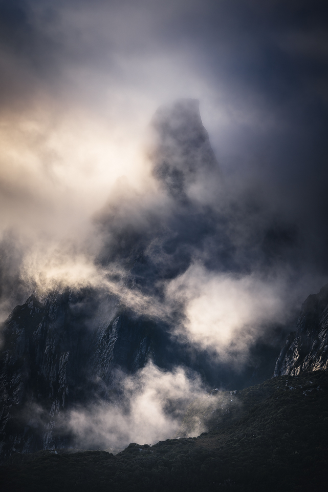 Morning mists engulf Federation Peak in the remote South West wilderness of Tasmania.