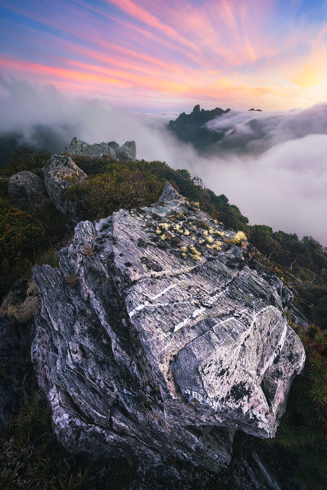 Fog envelops the Eastern Arthurs at sunset washing away any worries a world away from this inspiring wilderness area.