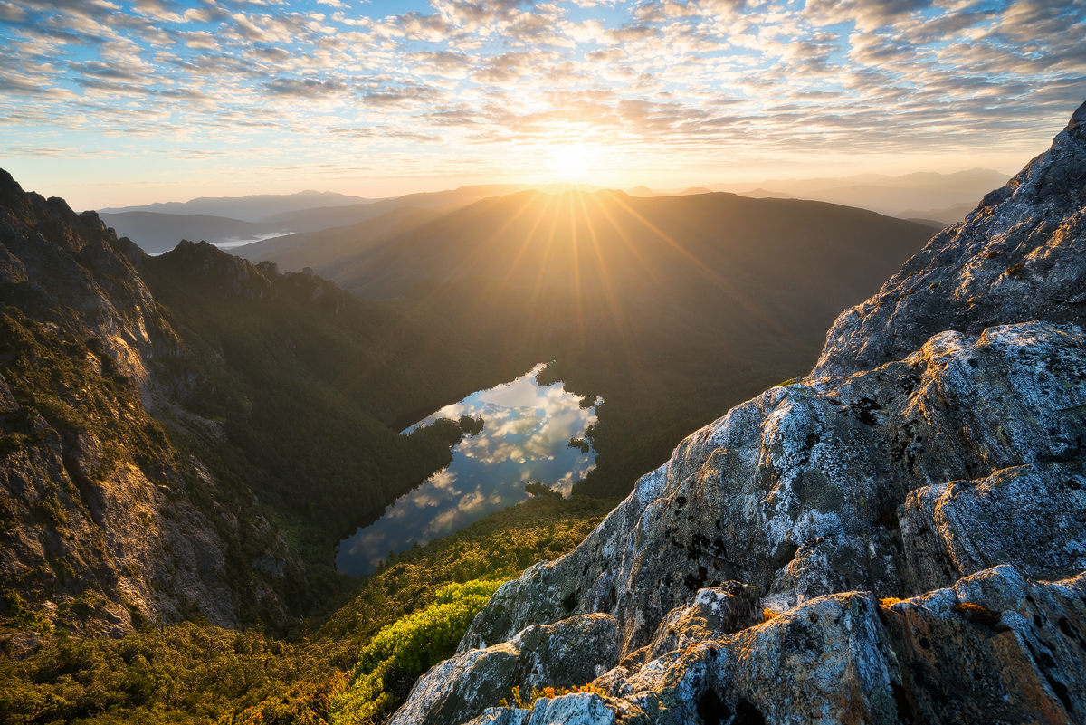 Sunrise from near Hanging Lake overlooking vast untouched wilderness punctuated by Lake Geeves in South West Tasmania.