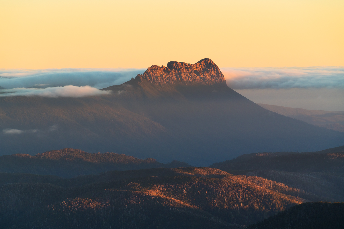 Precipitous Bluff and remote wilderness at sunset viewed from The Eastern Arthur Range in South West Tasmania, a UNESCO World Heritage area.