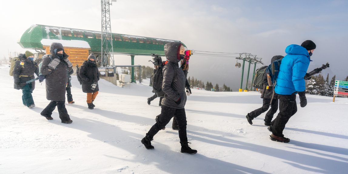 Winter sightseers at the top of the Lake Louise Ski Resort gondola in winter.